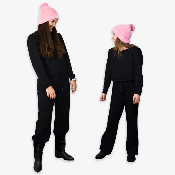 Sort blød jumpsuit med pufærmer og flared bukser til tweenpiger